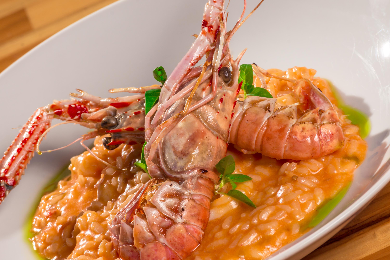 Risoto de lagostin e lula. Foto: Divulgação.